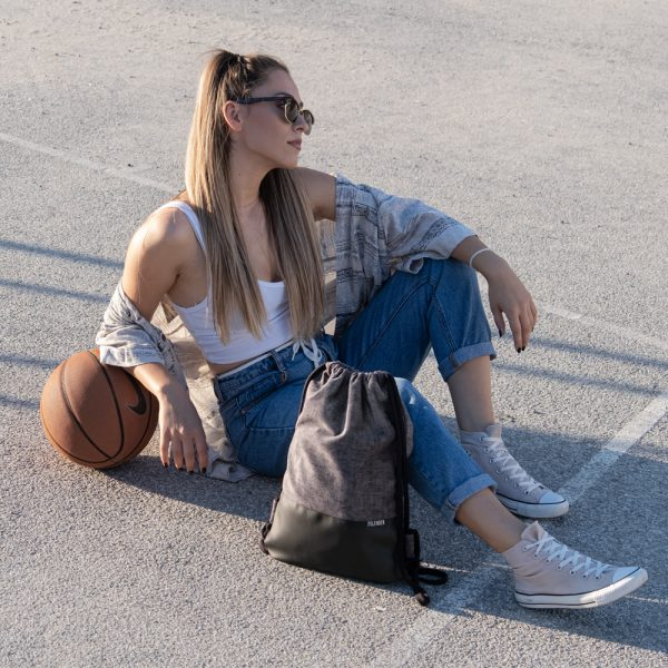 Young girl with Drawstring Bag and a basketball