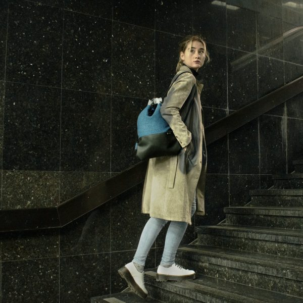 Young girl with Polender drawstring bag on the stairs